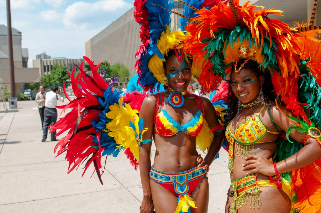 Dancers in colorful headdresses with feathers